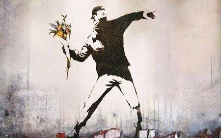 Banksy ragazzo lancia fiori